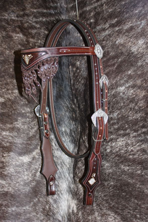 headstall with silver buckles and conchos